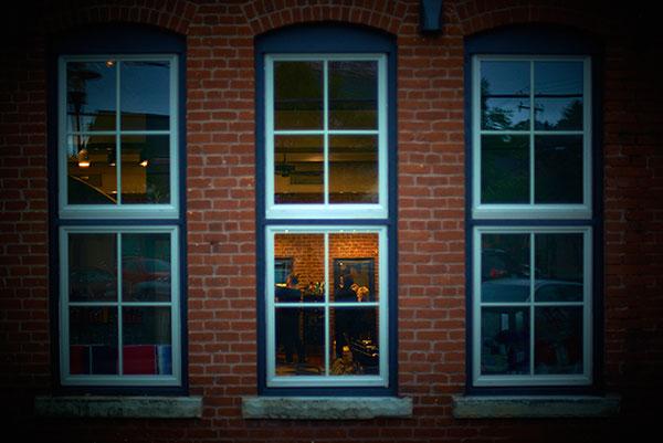 exterior shot of the windows at Sorella Hair Salon