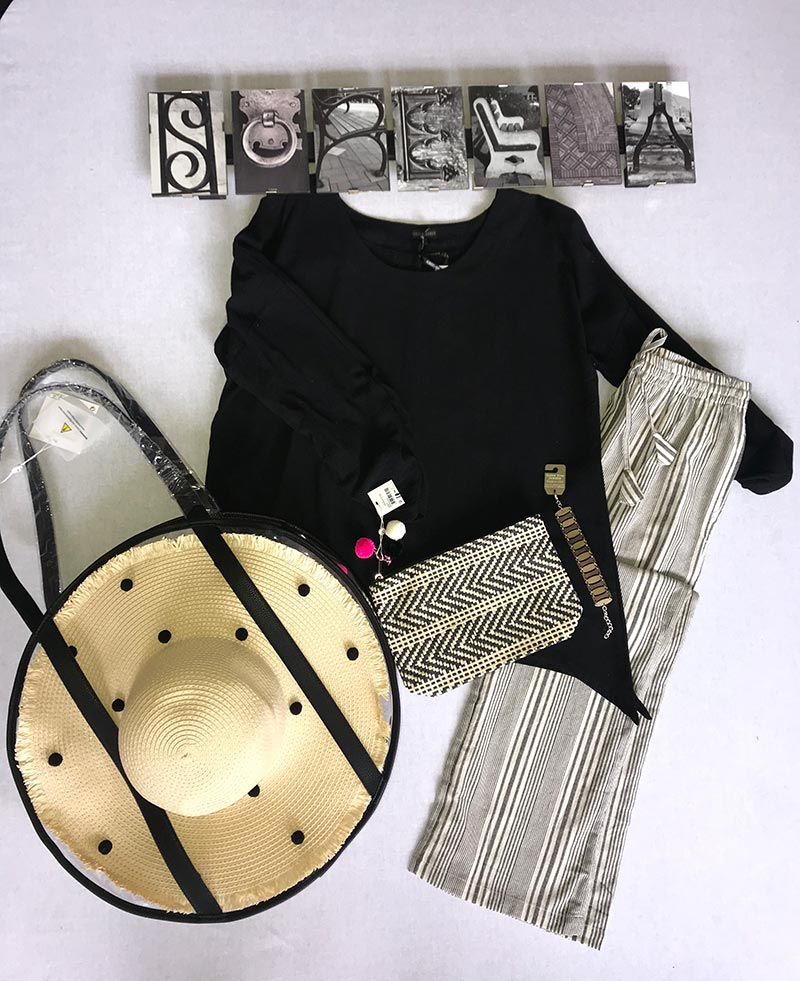 black shirt, straw hat, pants, purse, and bracelet