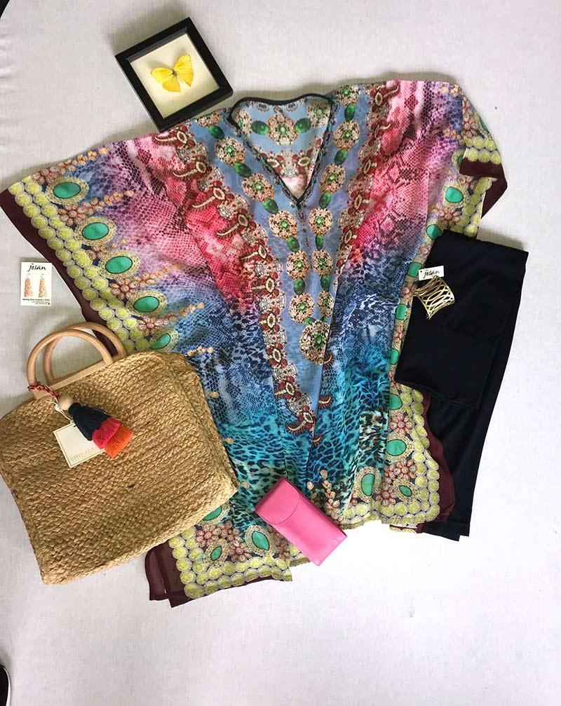 colorful blouse, jewelry, straw purse