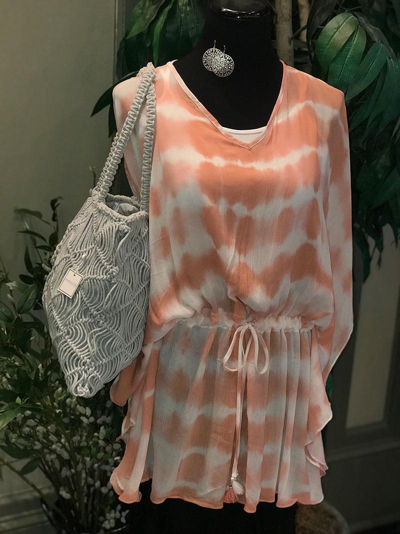 tie-dye blouse, white purse, earrings